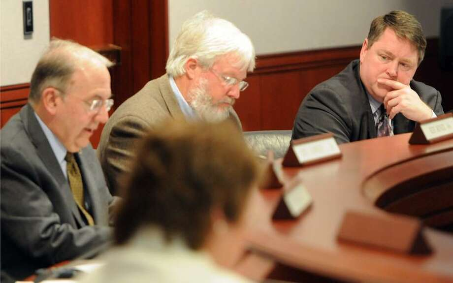 Republican State Representative Dan Carter, far right, listens to Democratic State Senator Martin Looney, far left, as Looney gives his presentation of  consensus proposals from Democratic legislators on the Gun Violence Prevention Working Group at the State Capitol's Legislative Office Building March 5, 2013.  Republican State Representative Craig Minor , center, is co-chairman with Looney of the   Gun Violence Prevention Working Group.  Photo by Peter Hvizdak / New Haven Register Photo: New Haven Register / ©Peter Hvizdak /  New Haven Register