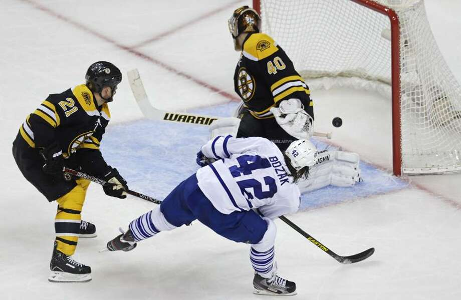 Toronto Maple Leafs center Tyler Bozak (42) beats Boston Bruins goalie Tuukka Rask (40) on a goal during the second period in Game 5 of an NHL hockey Stanley Cup playoff series in Boston, Friday, May 10, 2013. At left is Bruins' Andrew Ference (21). (AP Photo/Charles Krupa) Photo: AP / AP2013