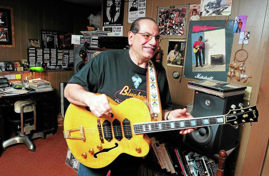 Blues guitarist Paul Gabriel is photographed at his home in Trumbull on 12/16/2013. Photo: (Arnold Gold - New Haven Register)