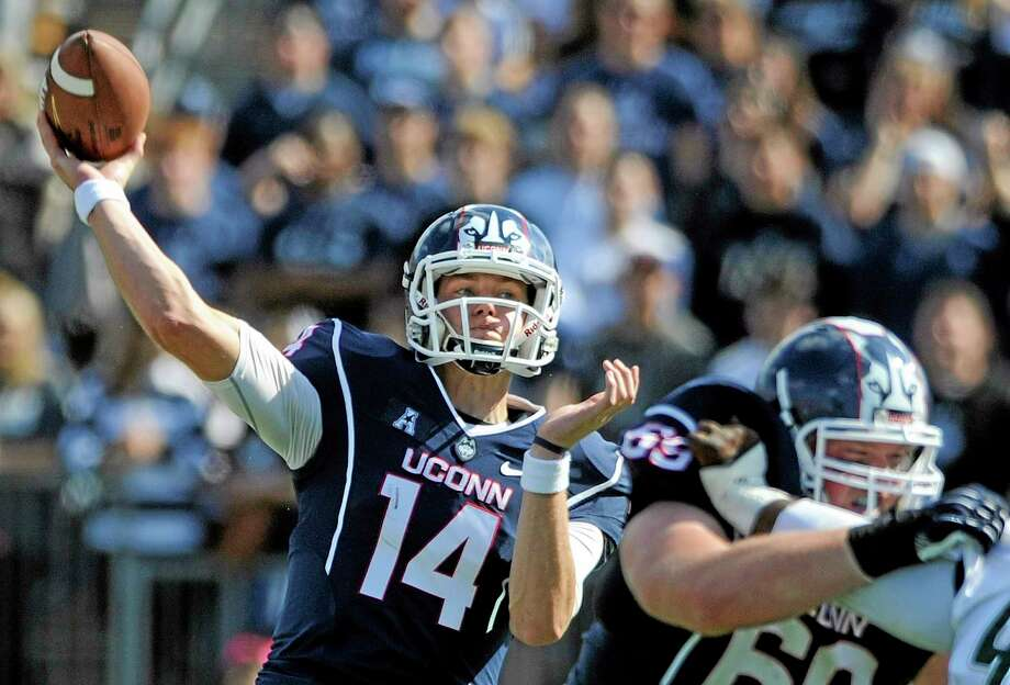UConn quarterback Tim Boyle throws a pass during the first half of his first collegiate start Saturday against South Florida at Rentschler Field in East Hartford. USF beat the Huskies 13-10. Photo: Fred Beckham — The Associated Press   / FR153656 AP