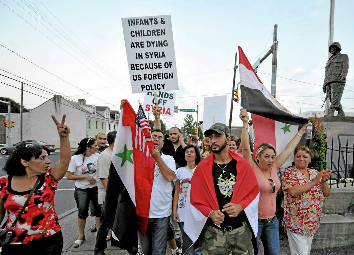 Members of the local Syrian community rally against the United States' involvement in Syria, Tuesday, Aug. 27, 2013 in Allentown, Pa. The United States, Britain and France have made it clear they believe the government of Syrian President Bashar Assad was behind a recent deadly chemical weapons attack in the suburbs of Damascus, and that such an act demands a swift international response. (AP Photo/Chris Post)