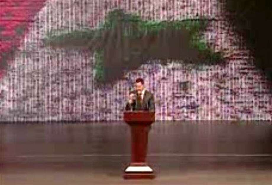 In this image taken from video obtained from Syrian State Television, which has been authenticated based on its contents and other AP reporting, Syrian President Bashar Assad speaks at the Opera House in central Damascus, Syria, Sunday, Jan. 6, 2013. Syrian President Bashar Assad on Sunday outlined a new peace initiative that includes a national reconciliation conference and a new government and constitution but demanded regional and Western countries stop funding and arming rebels first. (AP Photo/Syrian State Television via AP video) Photo: AP / Syrian State Television