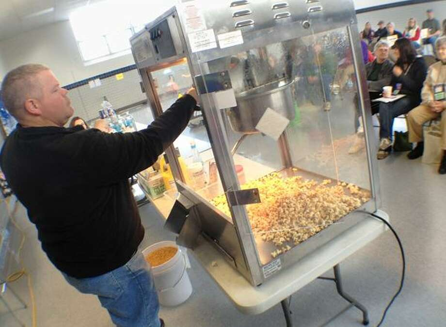 """Dispatch Staff Photo by JOHN HAEGER <a href=""""http://twitter.com/oneidaphoto"""">twitter.com/oneidaphoto</a> Dan Weed of New Hope , New York add corn to the popcorn maker during a workshop on Making and Selling Maple Popcorn, Ice Cream and Pop during the 18th annual New York Maple Producers Winter Conference at VVS on Saturday, Jan. 5, 2013 in Verona."""
