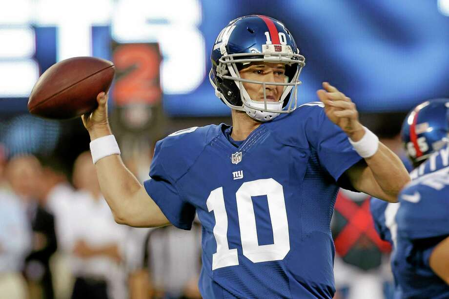 New York Giants quarterback Eli Manning throws a pass during the first half against the New York Jets on Saturday in East Rutherford, N.J. Photo: Julio Cortez — The Associated Press   / AP