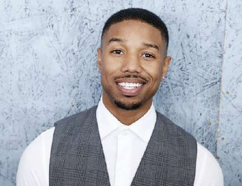 """In this May 16, 2013 file photo, actor Michael B. Jordan, from the film """"Fruitvale Station,"""" poses at the 66th international film festival, in Cannes. (Photo by Todd Williamson/Invision/AP, File)"""
