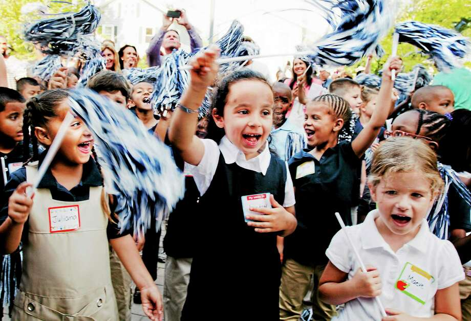 (Melanie Stengel — New Haven Register ) Left to Right: First graders,  Juliana Snedeker, Lindsay Offenburger, and Maeve Harrison cheer during the opening of East Rock Magnet School 8/28. Photo: Journal Register Co.