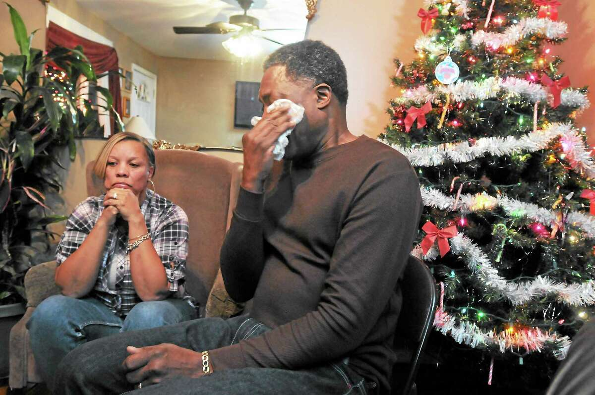 Celeste and Gregory Fulcher, parents of Key Club shooting victim Erika Robinson, at home in West Haven.