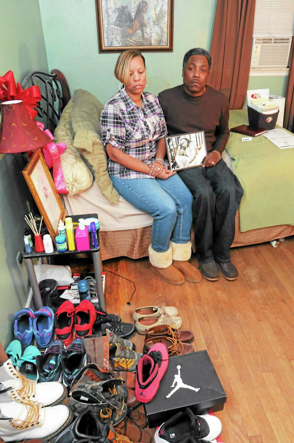 Celeste and Gregory Fulcher, parents of Key Club shooting victim Erika Robinson, in her bedroom at their home in West Haven.
