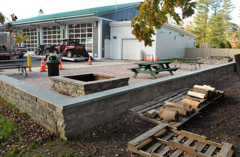 The Woodbridge Fire Department has been cited by the Inland Wetlands Commission for the construction of fire pits, a paver area, and a fence.  Mara Lavitt/New Haven Register