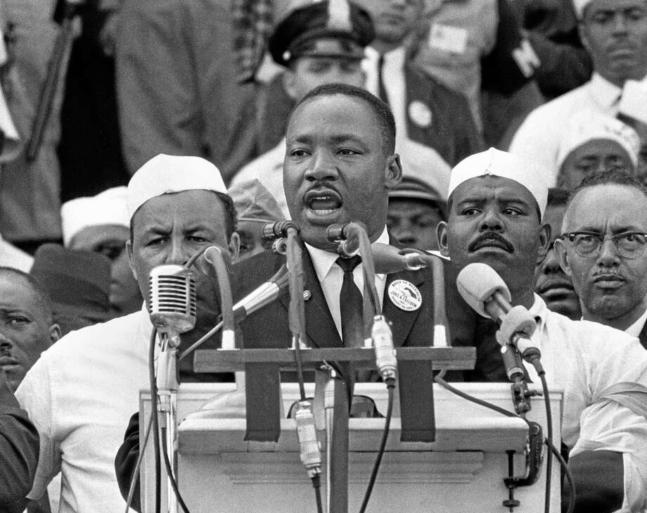 """FILE - In this Aug. 28, 1963, black-and-white file photo, Dr. Martin Luther King Jr., head of the Southern Christian Leadership Conference, addresses marchers during his """"I Have a Dream"""" speech at the Lincoln Memorial in Washington. President Barack Obama's presence at the ceremony, Wednesday, Aug. 28, 2013, celebrating the 50th anniversary of the March on Washington, will embody the dreams of the 250,000 people who rallied there decades ago for racial equality — and the continuing struggle by others for that goal. (AP Photo/File) Photo: AP / AP"""