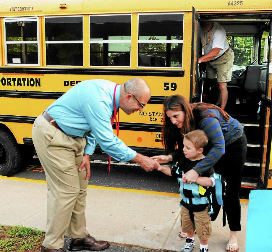 (Peter Hvizdak — Register)Bradley Elementary School principal Mario Ciccarini, left, with a student and teacher Sara Richard before the start of school Wednesday August 28, 2013. Photo: New Haven Register / ©Peter Hvizdak /  New Haven Register