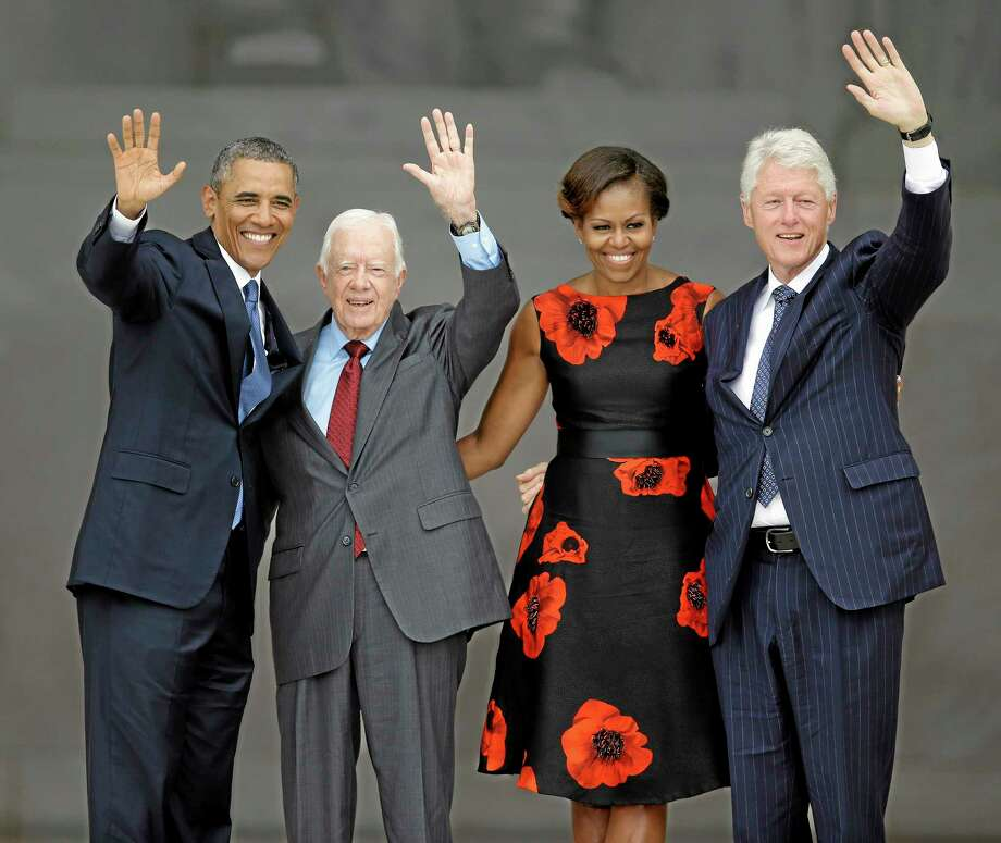 President Barack Obama, former President Jimmy Carter, first lady Michelle Obama and former President Bill Clinton wave at the end of the Let Freedom Ring ceremony at the Lincoln Memorial in Washington, D.C., Wednesday. Photo: Associated Press   / AP