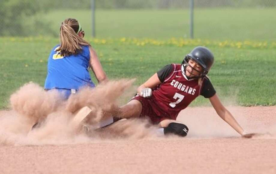 PHOTO BY JOHN HAEGER @ONEIDAPHOTO ON TWITTER/ONEIDA DAILY DISPATCH Stockbridge Valley's Sam Yates (7) slides into second for an RBI Double as Madison's Nikki Tubbs (3) attempts to make the tag during the bottom of the first inning of their game in Munnsville on Friday, May 10, 2013.