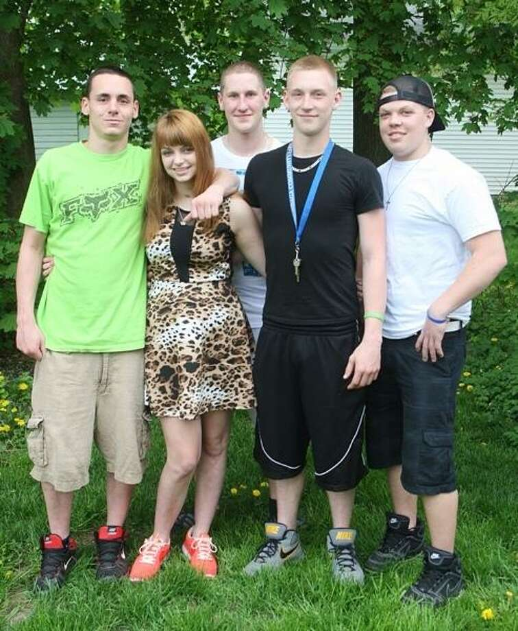 John Haeger @OneidaPhoto on Twitter/Oneida Daily Dispatch Justine Jakubowski poses with her brother, Jared Jakubowski, left, and Andrew Bavo, Benjamin Highers, and Brett Agan at her Oneida home on Friday, May 10, 2013. Justine was injured in a motor vehicle accident in May 2012 and told by doctors she would never walk again. She will be walking in the Grand March for 2013 Oneida Junior Prom on Saturday.
