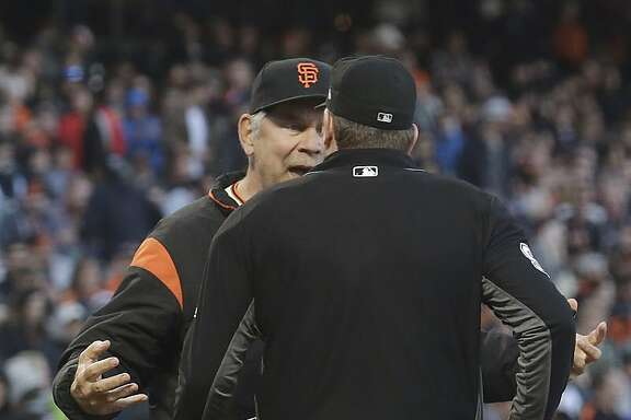 San Francisco Giants manager Bruce Bochy, rear, argues with umpire Chris Conroy after Pittsburgh Pirates' Andrew McCutchen's three-run home run during the second inning of a baseball game in San Francisco, Monday, July 24, 2017. (AP Photo/Jeff Chiu)