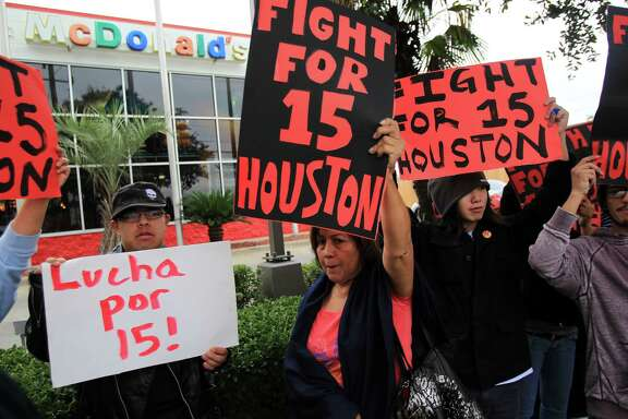 A 2013 protest outside a McDonalds on Kirby near U.S. 59 in Houston called for an increase in the minimum wage. (Chronicle file photo)