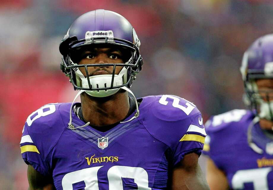 Minnesota Vikings running back Adrian Peterson is back practicing with the team. Reports surfaced that his 2-year-old son was assaulted and is in critical condition. Photo: Matt Dunham — The Associated Press   / AP