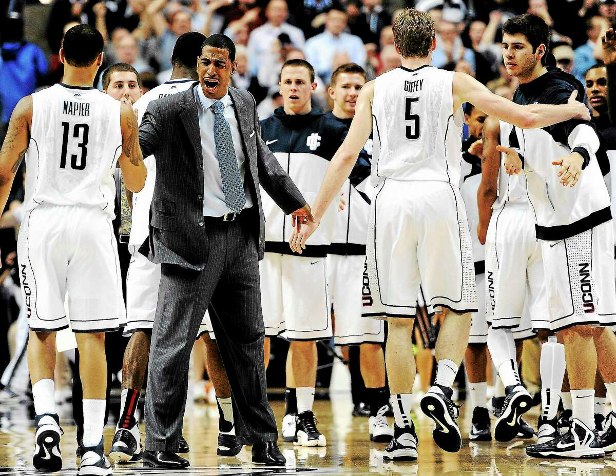UConn coach Kevin Ollie cheers his team on during the second half of a 79-78 loss to Georgetown in Storrs on Feb. 27.