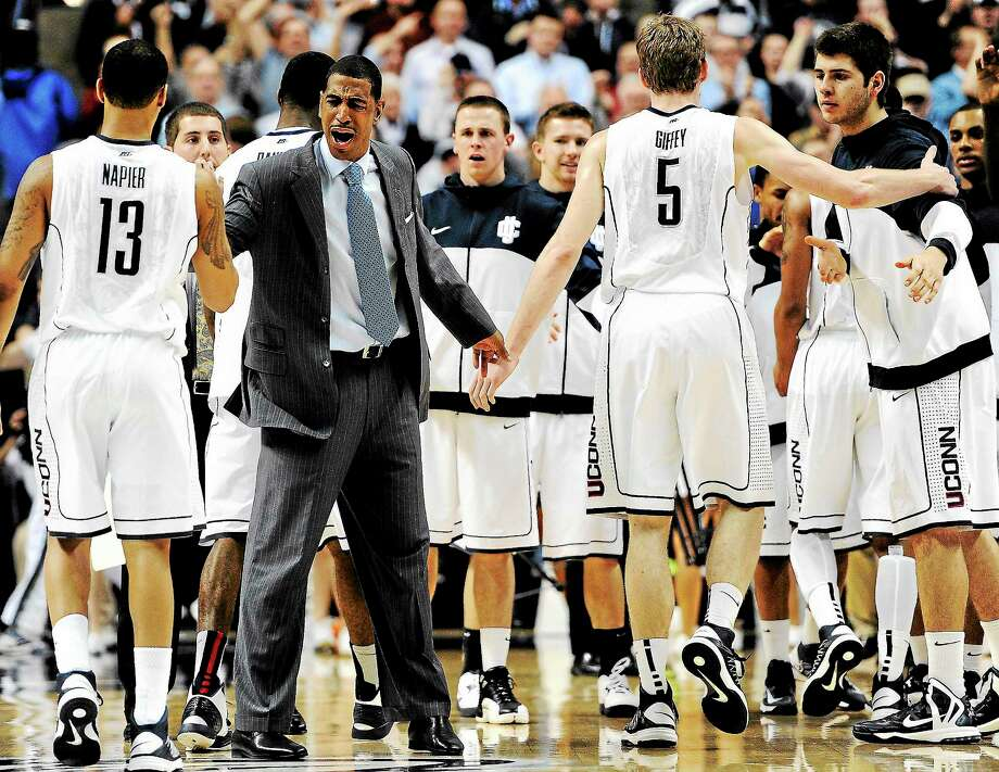 UConn coach Kevin Ollie cheers his team on during the second half of a 79-78 loss to Georgetown in Storrs on Feb. 27. Photo: Jessica Hill — The Associated Press   / AP2013