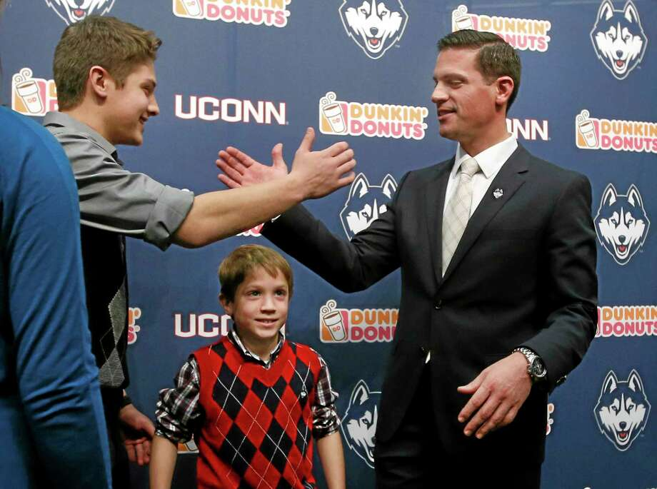 Landing Bob Diaco, right, as the new head football coach certainly loooks like a good move for UConn, but whether or not he can author quick turnaround for the Huskies remains to be seen. Photo: Elisa Amendola — The Associated Press   / AP