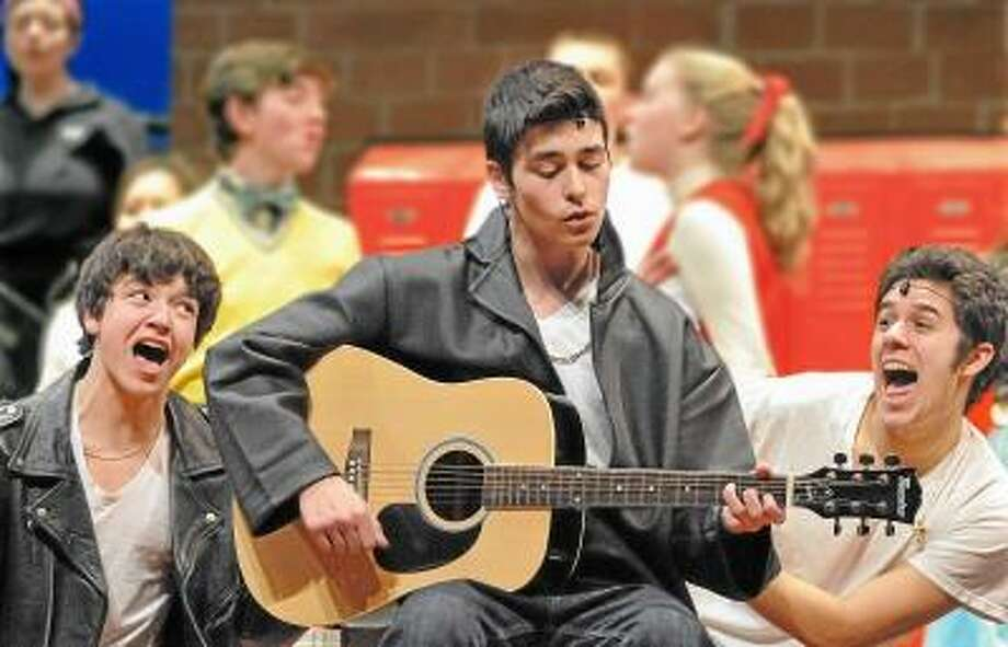 Catherine Avalone/The Middletown Press  Ian Pekar as Danny Zuko, center, Justin Keib as Doody,at left and Nick Maturo as Roger, at right  perform dress rehearsal Tuesday night in the Mercy and Xavier High School's production of Grease. The shows are this weekend,  Friday and Saturday at 7:30 p.m. and Sunday at 2 p.m. at the Mercy High School auditorium. Tickets are $10. / TheMiddletownPress