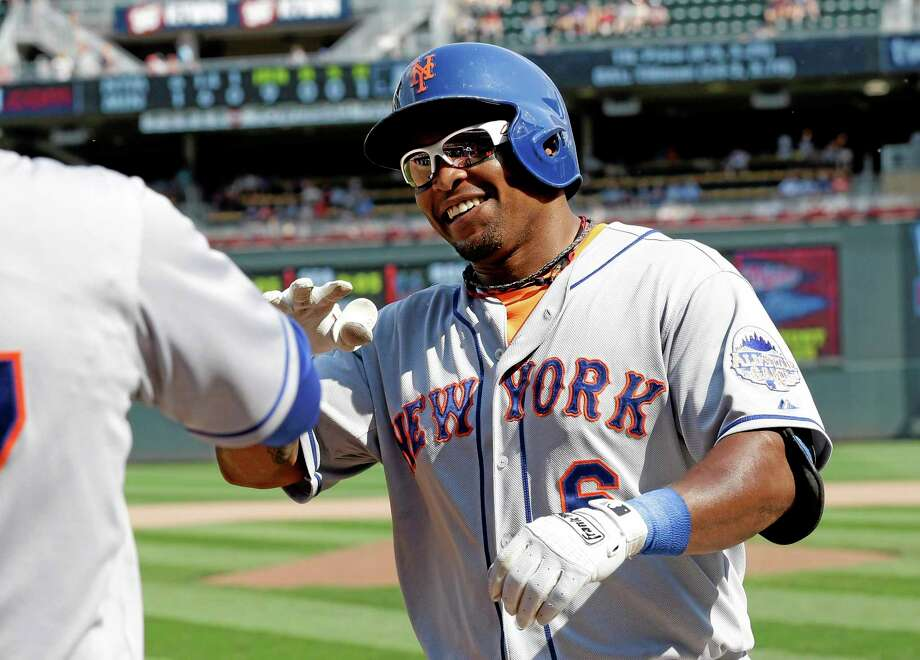New York Mets' Marlon Byrd is all smiles after his solo home run off Minnesota Twins pitcher Jared Burton in the ninth inning of a baseball game, Monday, Aug. 19, 2013 in Minneapolis. The Mets won 6-1. (AP Photo/Jim Mone) Photo: AP / AP