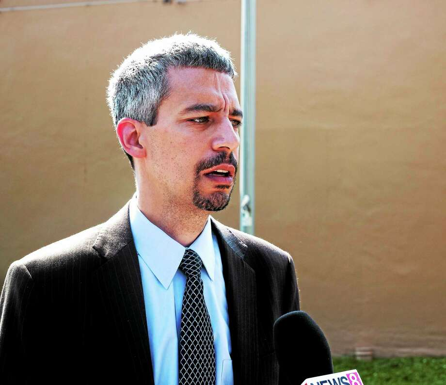 Mayoral candidate Henry Fernandez talks about crime reduction strategies outside of Club Vandome. Photo by Rich Scinto/ New Haven Register. Photo: Journal Register Co.