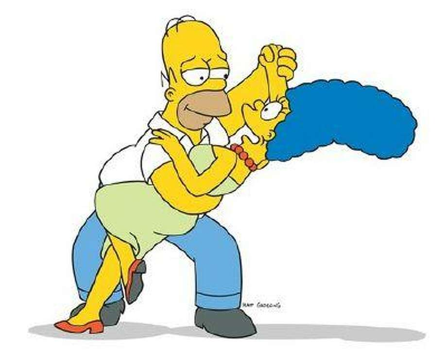 """Homer and Marge Simpson in """"The Simpsons."""""""