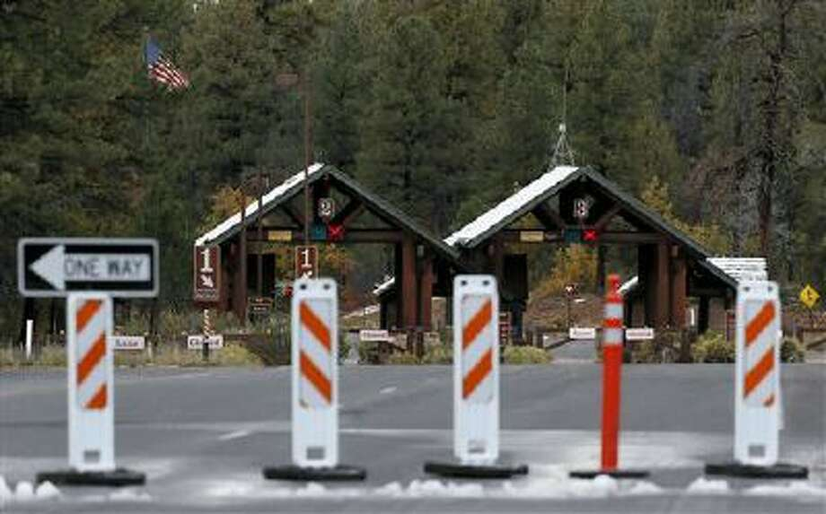 The main entrance to Grand Canyon National Park remains closed to visitors on Thursday Oct. 10, 2013, in Grand Canyon, Ariz. (AP Photo/Ross D. Franklin) Photo: AP / AP