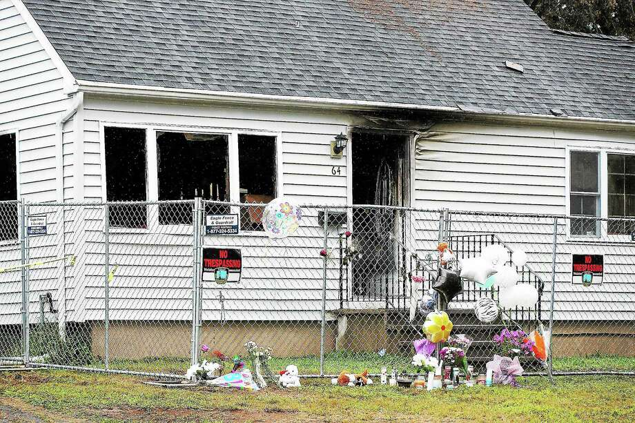 Peter Casolino — RegisterA makeshift memorial outside the home at 64 Charter Oak damaged by last Friday's plane crash. There was not much activity on Tuesday, except East Haven police guarding the site.pcasolino@newhavenregister.com Photo: Journal Register Co.
