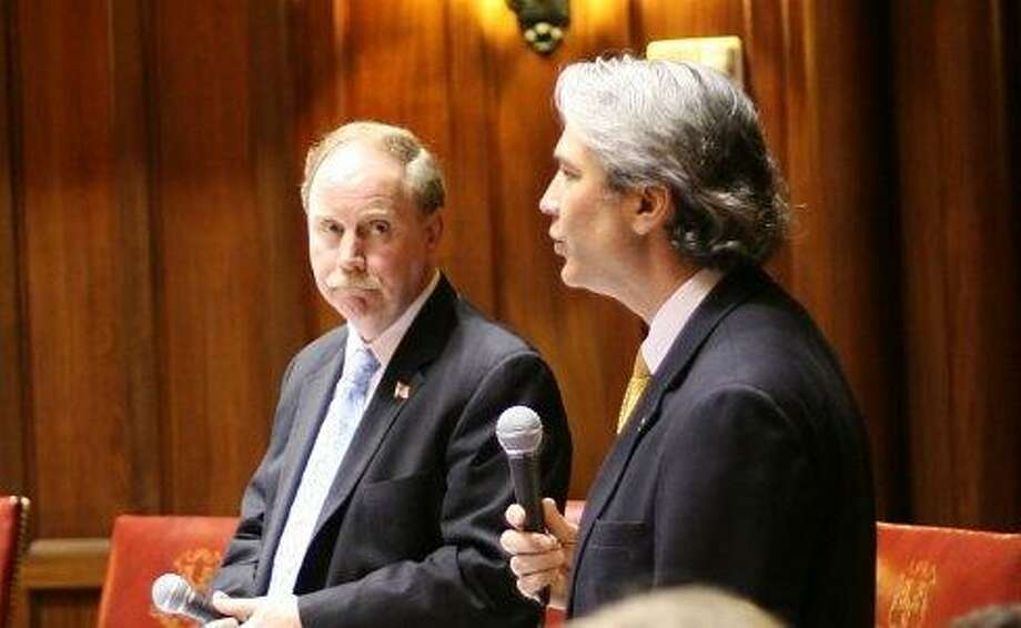 Sens. Anthony Musto and Michael McLachlan debate bill. Hugh McQuaid photo