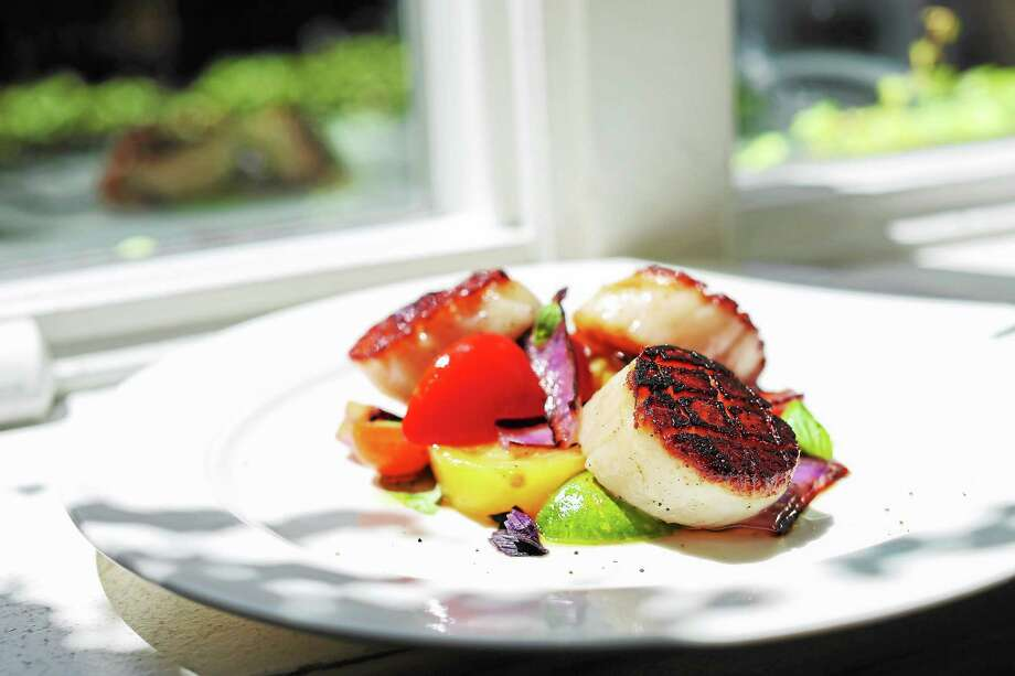 Sea Scallops Alla Caprese are cooked on a piastra, a slab of granite put directly over the grill, but a cast iron griddle will do. Photo: Kate Previte