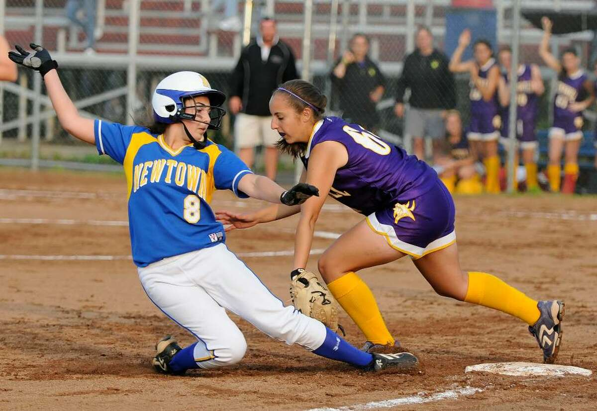 Newtown #8 Megan Gibbons slides safely under the tag of Westhill #64 Cassandra Kish. Westhill High School bests Newtown High School in the Class LL Softball Championship at DeLuca Field in Stratford on Saturday evening June 12, 2010.