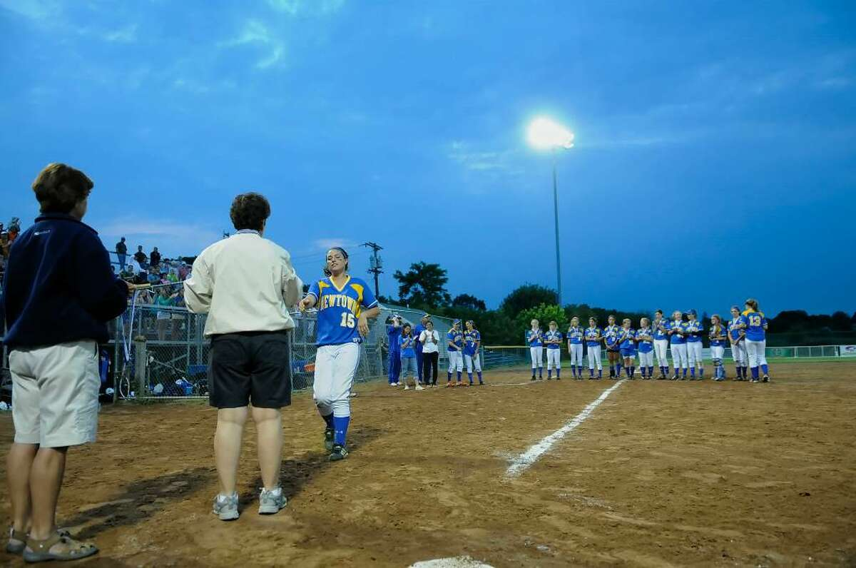 Newtown receives their runner-up medals. Westhill High School bests Newtown High School in the Class LL Softball Championship at DeLuca Field in Stratford on Saturday evening June 12, 2010.