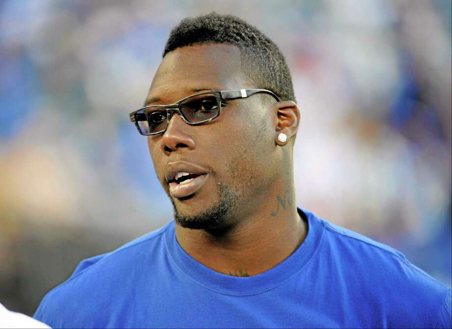 New York Giants defensive end Jason Pierre-Paul looks on before a preseason NFL football game against the New York Jets, Saturday, Aug. 24, 2013, in East Rutherford, N.J. (AP Photo/Bill Kostroun) Photo: AP / FR51951 AP