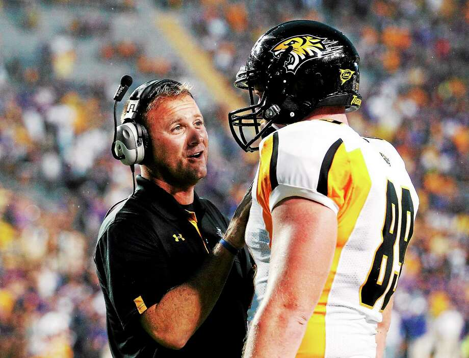 Towson coach Rob Ambrose, left, talks with tight end Tanner Vallely during a game against LSU last season. Photo: Bill Haber — The Associated Press   / AP2012