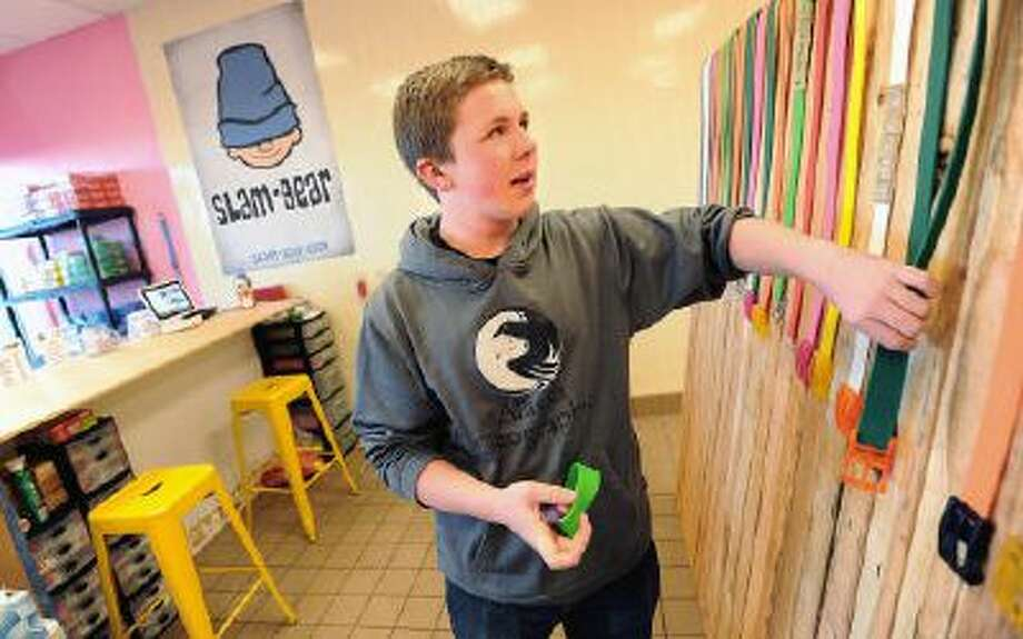 Sam Gambee, a 14-year-old Monarch High School student, had trouble finding a job so he and his dad, Tony, opened up their own store called Slam Gear in Superior, Colo. Photo: DC / Daily Camera