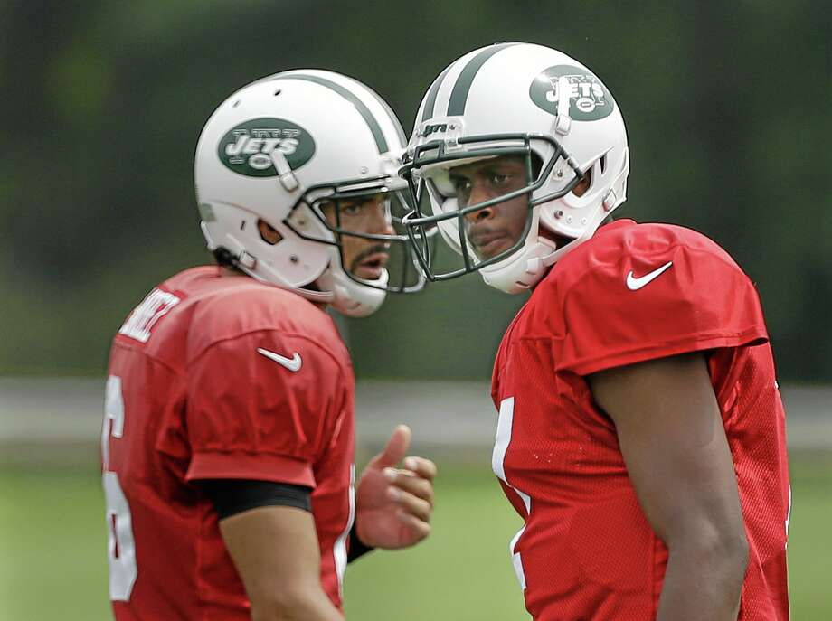 New York Jets quarterbacks Geno Smith, right, and Mark Sanchez participate in a practice in Florham Park, N.J., Monday, Aug. 19, 2013. Photo: Seth Wenig — The Associated Press   / AP
