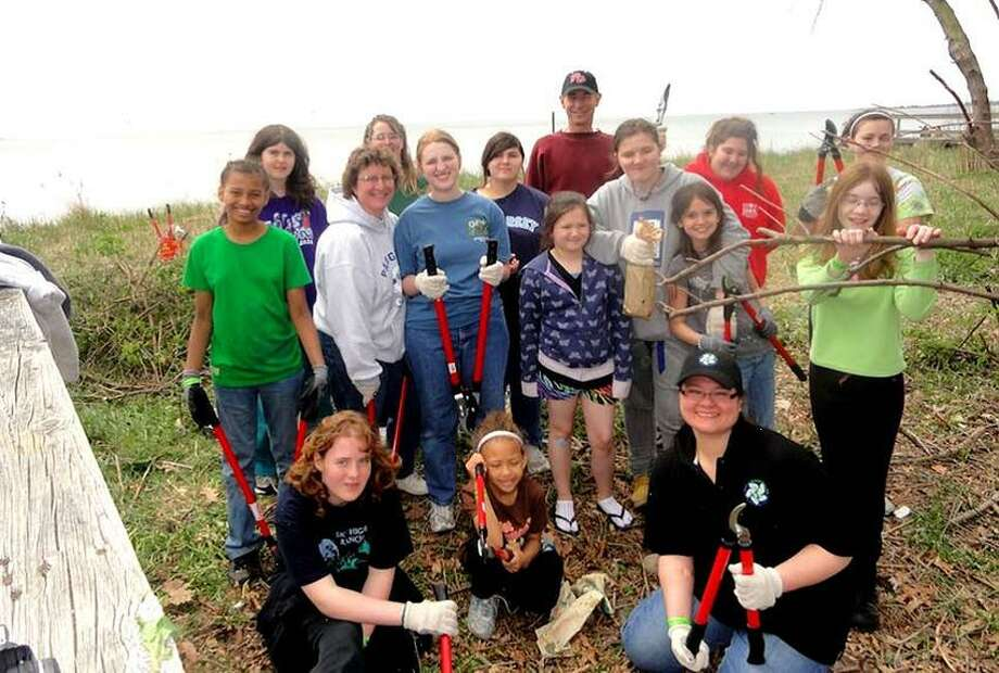 Contributed photo: Girl Scout Troops 38369 and 38318, their leaders and site leaders helped in last year's Walnut Beach invasive plant removal.