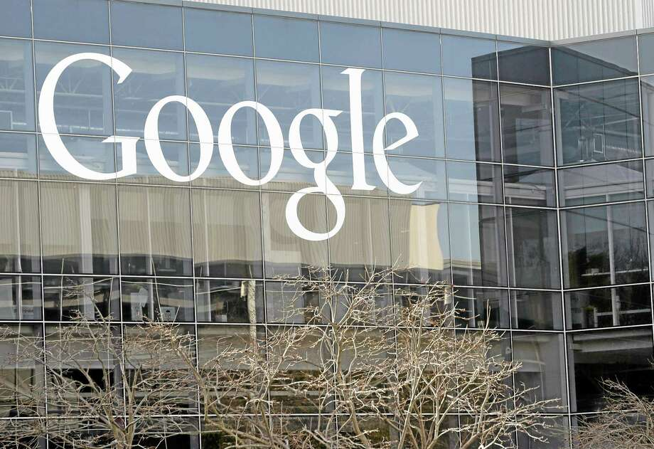 Marcio Jose Sanchez — The Associated Press file photo  The Google sign at the company's headquarters in Mountain View, Calif. Google wants your permission to use your name, photo and product reviews in ads that it sells to businesses. Photo: AP / AP