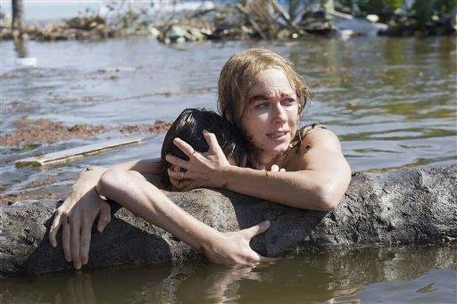 """This publicity film image released by Summit Entertainment shows Naomi Watts in a scene from the film, """"The Impossible."""" (AP Photo/Summit Entertainment, Jose Haro) Photo: AP / Summit Entertainment"""
