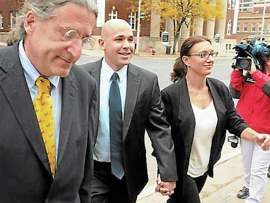 East Haven police Officer Jason Zullo, center, with attorney Norman Pattis, left, and an unidentified woman, walks to court in Hartford in October 2012. Photo: Mara Lavitt — New Haven Register