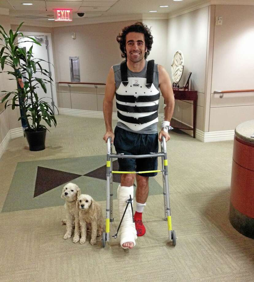 In this photo provided by Team Chip Ganassi Racing, IndyCar driver Dario Franchitti poses with his dogs, Shug and Buttermilk, in a photo taken by his brother, Marino Franchitti, at Memorial Hermann-Texas Medical Center in Houston on Thursday. Photo: Marino Franchitti — The Associated Press   / Team Chip Ganassi Racing