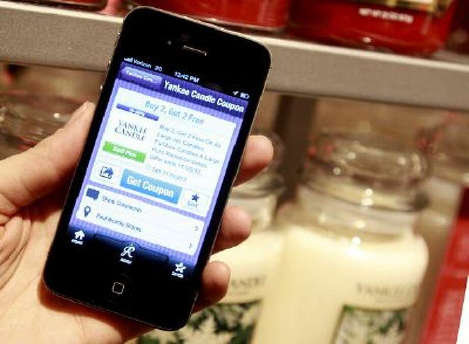 Stores like Target, Walmart, Kmart, Costco and Sam's Club now offer apps to help you save at their stores. Photo: Boston Globe Via Getty Images / 2013 - The Boston Globe