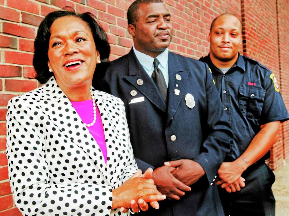 (Melanie Stengel — New Haven Register ) Left to right:Mayoral candidate, Toni Harp, with firefighters Michael Neal and Leon Brown Jr. 08/26.  Neal is President of the Firebirds, Brown is Vice President. The firebirds have endorsed Harp. Photo: Journal Register Co.