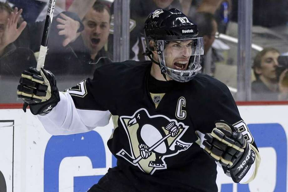 Pittsburgh Penguins' Sidney Crosby (87) celebrates after scoring during the second period of Game 5 of an NHL hockey Stanley Cup first-round playoff series against the New York Islanders, Thursday, May 9, 2013, in Pittsburgh. (AP Photo/Gene J. Puskar) Photo: AP / AP2013
