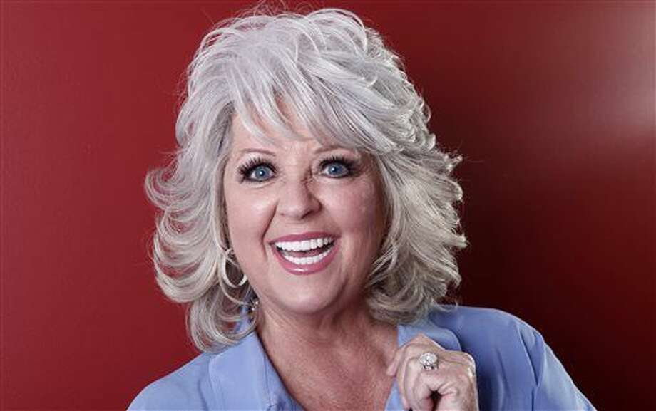 FILE - In this Jan. 17, 2012 file photo, celebrity chef Paula Deen poses for a portrait in New York. A federal judge in Georgia on Monday, Aug. 12, 2013 threw out race discrimination claims by a former Savannah restaurant manager whose lawsuit against Deen ended up causing the celebrity cook to lose a big slice of her culinary empire. (AP Photo/Carlo Allegri, File) (Carlo Allegri)