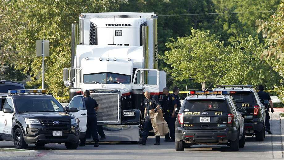 Law enforcement at the scene, where people were discovered inside a tractor trailer in a Walmart parking lot at IH35 South and Palo Alto Road, Sunday, July 23, 2017. Reports say that 8 were dead and several were in critical condition. Photo: Edward A. Ornelas, Staff / San Antonio Express-News / © 2017 San Antonio Express-News