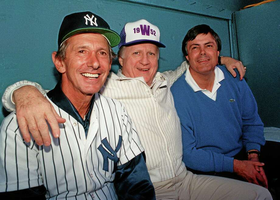 "Former Yankees owner George Steinbrenner is flanked by fifth-time manager Billy Martin, left, and vice president and general manager Lou Piniella, right, at spring training in 1988 in Fort Lauderdale, Fla. The feud between Alex Rodriguez and the Yankees brings back memories of the days of Reggie Jackson vs. Billy Martin vs. George Steinbrenner, a time where the team was nicknamed the ""Bronx Zoo."" (AP Photo/Bill Cooke, File) Photo: Bill Cooke — The Associated Press File Photo   / AP"
