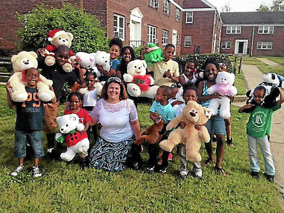 Children at the Crestbury Apartments in Camden, N.J., receive stuffed animals. Photo: Contributed Photo
